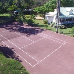 Red clay tennis court at Llantrissant